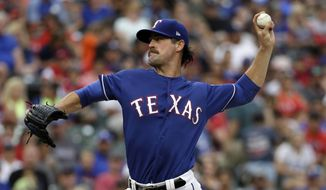 Texas Rangers starting pitcher Cole Hamels throws to the Los Angeles Angels in the second inning of a baseball game, Friday, July 7, 2017, in Arlington, Texas. (AP Photo/Tony Gutierrez)