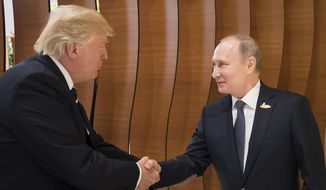 In this photo provided by German government U.S. President Donald Trump, left, shakes hand with Russian President Vladimir Putin before the first working session of the G-20 summit in Hamburg, northern Germany. (Steffen Kugler/Presse- und Informationsamt der Bundesregierung via AP)