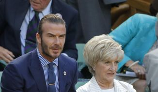 David Beckham, left and his mother Sandra, sits in the Royal Box on day five at the Wimbledon Tennis Championships in London Friday, July 7, 2017. (AP Photo/Alastair Grant)