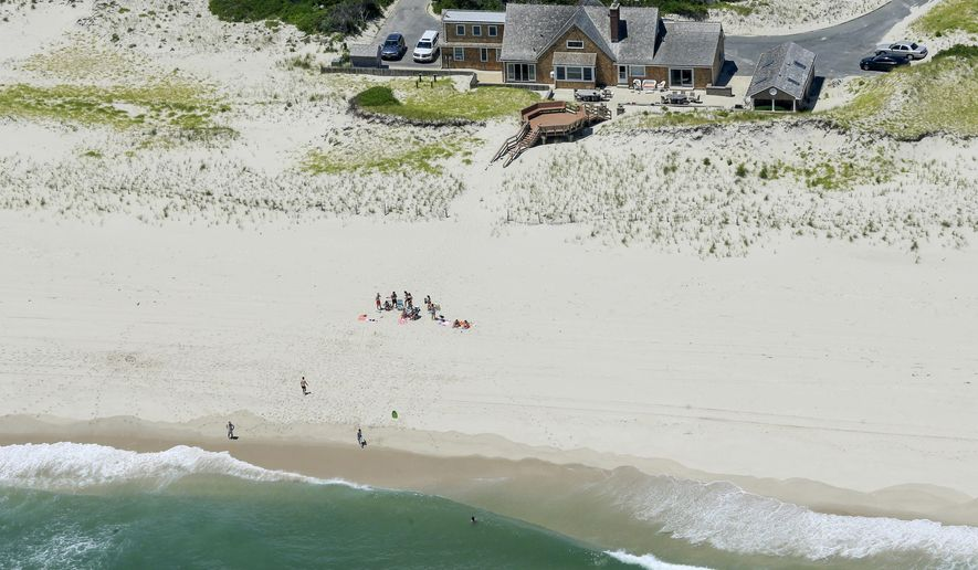 In this Sunday, July 2, 2017, photo, New Jersey Gov. Chris Christie uses the beach with his family and friends at the governor's summer house at Island Beach State Park in New Jersey. Democratic Assemblyman John Wisniewski said Friday, July 7, 2017, he has introduced a bill that would let the public rent the house on Island Beach State Park that is now reserved for the governor. A second bill would prevent the beach house to be used by the governor during any state shutdown.(Andrew Mills/NJ Advance Media via AP)