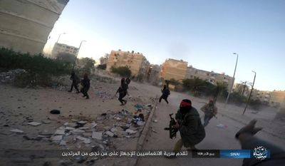 This photo posted on a file sharing website Wednesday, Jan. 11, 2017, by the Islamic State Group in Sinai, a militant organization, shows a deadly attack by militants on an Egyptian police checkpoint, in el-Arish, north Sinai, Egypt. (Islamic State Group in Sinai via AP, File )