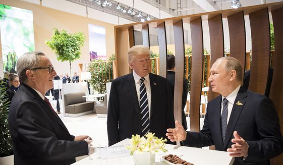 "President Trump, who met with Russian President Vladimir Putin on the sidelines of the Group of 20 summit in Germany last week, felt compelled Sunday to respond to his critics. ""I strongly pressed President Putin twice about Russian meddling in our election. He vehemently denied it. I've already given my opinion,"" Mr. Trump tweeted. Pictured at left is European Commission President Jean-Claude Juncker. (Associated Press)"