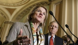 In this Jan. 20, 2015, file photo, Sen. Shelley Moore Capito, R-W.Va., accompanied by Senate Majority Leader Mitch McConnell of Ky., speaks during a news conference on Capitol Hill in Washington. (AP Photo/J. Scott Applewhite, File)