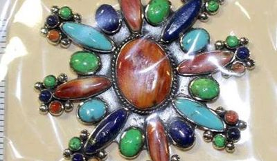 In this undated photo provided by U.S. Fish and Wildlife Service shows fake Native American styled-jewelry seized by federal officials during a 2015 investigation in New Mexico. Federal prosecutors are preparing for trial in an ambitious investigation that traced falsified Native American art from the Philippines to galleries across the United States. Efforts to prevent the sale of counterfeit tribal art and jewelry will be the focus of testimony Friday, July 7, 2017, as two U.S. senators hold a field hearing in New Mexico about protecting legitimate American Indian artists and markets from fraudulent goods. (U.S. Fish and Wildlife Service via AP)