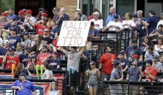 """A fan holds up a sign reading """"Rally for Tito"""" in the first inning of a baseball game between the Detroit Tigers and the Cleveland Indians, Friday, July 7, 2017, in Cleveland. Indians manager Terry Francona underwent a procedure Thursday to correct an irregular heartbeat that sidelined him for a few games and will prevent him from managing in the All-Star Game next week.(AP Photo/Tony Dejak)"""