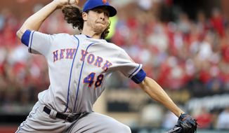New York Mets starting pitcher Jacob deGrom throws during the first inning of a baseball game against the St. Louis Cardinals, Friday, July 7, 2017, in St. Louis. (AP Photo/Jeff Roberson)