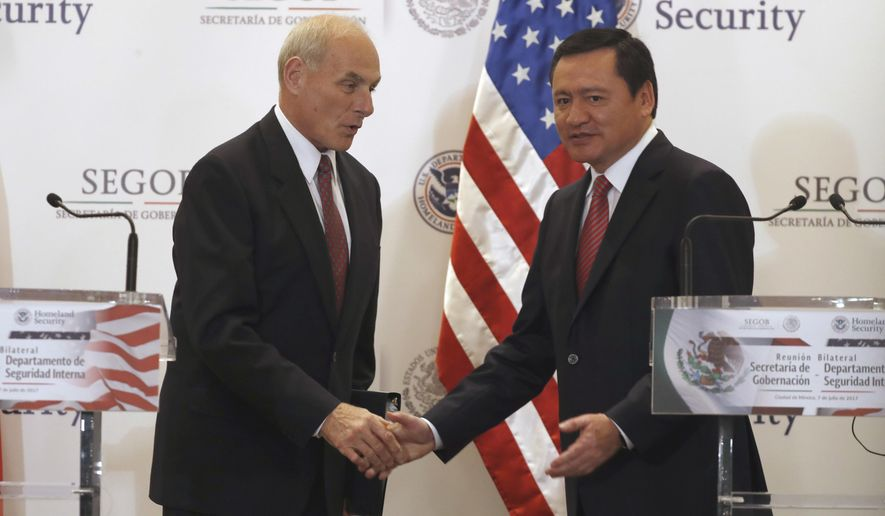 Mexico's Interior Secretary Miguel Angel Osorio Chong, right, greets U.S. Homeland Security Secretary John Kelly after a joint statement at the end of Kelly's visit in Mexico City Friday, July 7, 2017. Kelly arrived to Mexico on Wednesday and met with President Enrique Pena Nieto before the Mexican leader departed for France ahead of the Group of 20 summit in Germany. Late Thursday Kelly accompanied military leaders to the southern state of Guerrero, one of the country's primary opium-producing states.(AP Photo/Eduardo Verdugo)