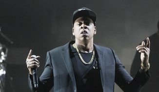 In this Nov. 4, 2016, file photo, Jay-Z performs during a campaign rally for Democratic presidential candidate Hillary Clinton in Cleveland. (AP Photo/Matt Rourke, File)