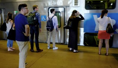 """In this Friday, June 30, 2017 photo, commuters wait to board a NJ Transit train bound for New York's Penn Station at Secaucus Junction, in Secaucus, N.J. A massive two-month repair project will launch Monday, July 10 at Penn Station, the country's busiest train station, temporarily exacerbating the daily commuting struggle during what New York's governor has predicted will be a """"summer of hell.""""  Frequent delays, overcrowding and breakdowns are leaving many to question the city's ability to effectively transport its workforce.   (AP Photo/Julio Cortez)"""