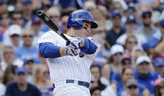 Chicago Cubs' Anthony Rizzo hits a two-run home run off Pittsburgh Pirates starting pitcher Trevor Williams, also scoring Kris Bryant, during the fourth inning of a baseball game Friday, July 7, 2017, in Chicago. (AP Photo/Charles Rex Arbogast)