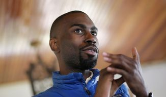 In this March 26, 2016, file photo, Black Lives Matter activist DeRay Mckesson chats with campaign volunteers in Baltimore. A federal lawsuit accuses Black Lives Matter and several movement leaders of inciting violence that led to a gunman's deadly ambush of law enforcement officers in Baton Rouge last summer. Mckesson and four other Black Lives Matter leaders are named as defendants in the suit filed Friday on behalf of one of the officers wounded in the July 17 attack by a black military veteran, who killed three other officers before he was shot dead. (AP Photo/Patrick Semansky, File)