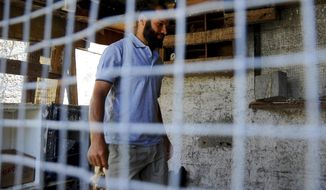 In this photo dated Sunday, June 18, 2017, Salah Sassi , a former Guantanamo detainee, is pictured during an interview with the Associated Press at his home in Bizerte, northern Tunisia. Two Tunisians freed after years in the U.S. detention center at Guantanamo Bay, Cuba, say they are harassed relentlessly by security forces at home. Neither has ever been charged, and they say they almost yearn to return to captivity in Cuba than face the injustice and isolation they say they now endure.(AP Photo/Hassene Dridi)