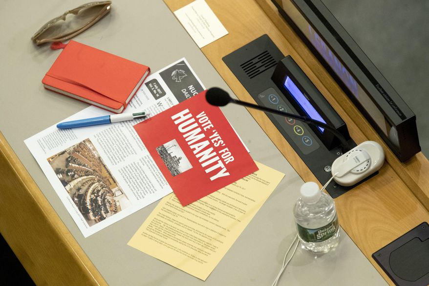 Leaflets are seen on a delegates desk before a vote by the conference to adopt a legally binding instrument to prohibit nuclear weapons, leading towards their total elimination, Friday, July 7, 2017 at United Nations headquarters. More than 120 countries have approved the first-ever treaty banning nuclear weapons at a U.N. meeting boycotted by all nuclear-armed nations. Friday's vote was 122 countries in favor with the Netherlands opposed and Singapore abstaining.(AP Photo/Mary Altaffer)