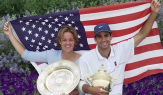 "FILE - In this  Sunday, July 4, 1999 file photo, Americans Lindsay Davenport, left, and Pete Sampras pose with their trophies and an American flag following their victories in the Women's and Men's Singles at Wimbledon. Three-time major champion and former No. 1 Lindsay Davenport of the U.S will serve as a ""legend ambassador"" for the WTA Finals, announced by the WTA on Thursday July 6, 2017, which will be held in Singapore from Oct. 22-29. (AP Photo/Adam Butler, File)"