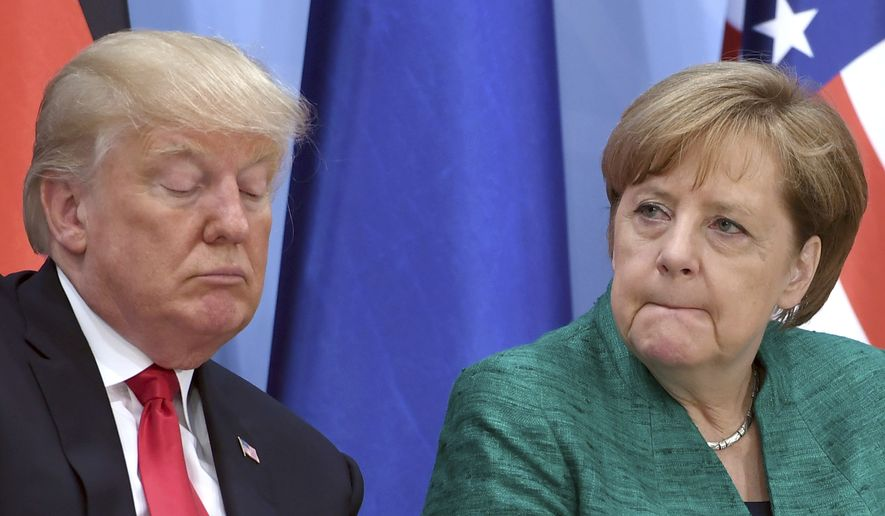 U.S.  president Donald Trump, left, and German chancellor Angela Merkel attend the  Women's Entrepreneur Finance Initiative launch event held in conjunction with the G-20 summit in Hamburg, Germany, Saturday, July 8, 2017.  (Patrik Stollarz/Pool Photo via AP)