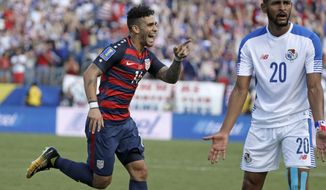 United States' Dom Dywer (14) celebrates after scoring a goal as Panama's Anibal Godoy (20) reacts during a CONCACAF Gold Cup soccer match Saturday, July 8, 2017, in Nashville, Tenn. (AP Photo/Mark Humphrey)