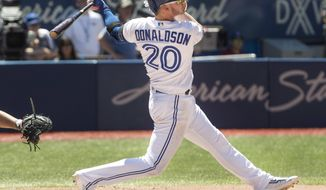 Toronto Blue Jays' Josh Donaldson hits a three-run home run against the Houston Astros in the fifth inning of their baseball game in Toronto on Saturday, July 8, 2017. (Fred Thornhill/The Canadian Press via AP)