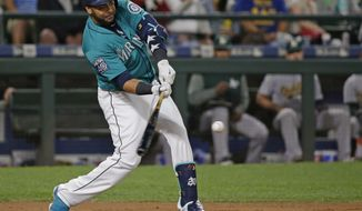 Seattle Mariners' Nelson Cruz hits a three-run home run during the eighth inning of the team's baseball game against the Oakland Athletics, Friday, July 7, 2017, in Seattle. (AP Photo/Ted S. Warren)