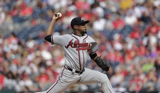 Atlanta Braves starting pitcher Julio Teheran pitches during the first inning of a baseball game against the Washington Nationals, Saturday, July 8, 2017, in Washington. (AP Photo/Mark Tenally)
