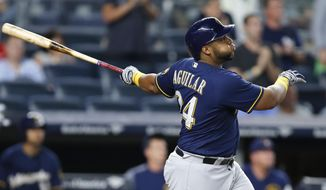 Milwaukee Brewers' Jesus Aguilar watches his grand slam against the New York Yankees during the seventh inning of a baseball game in New York, Friday, July 7, 2017. (AP Photo/Kathy Willens)