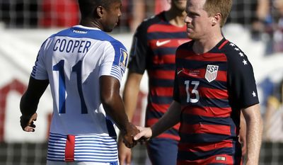 Panama's Armando Cooper (11) shakes hands with United States' Dax McCarty (13) after playing to a 1-1 tie in a CONCACAF Gold Cup soccer match Saturday, July 8, 2017, in Nashville, Tenn. (AP Photo/Mark Humphrey)