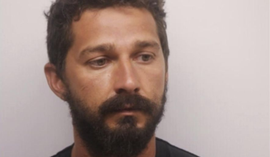 In this Saturday, July 8, 2017, photo released by the Chatham County Sheriff's Office, actor Shia LaBeouf poses for a booking photo, in Savannah, Ga. LaBeouf has been released from a Georgia jail after posting $7,000 bond on charges of public drunkenness. In addition to the public drunkenness charge, he also was arrested for disorderly conduct and obstruction. Further details surrounding the arrest were not immediately available. (Chatham County Sheriff's Office via AP)