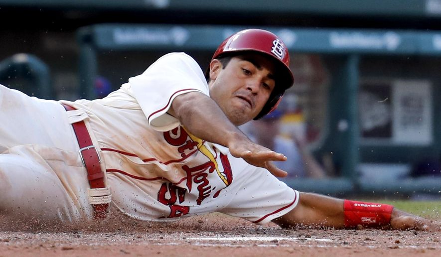 St. Louis Cardinals' Alex Mejia scores during the eighth inning of a baseball game against the New York Mets, Saturday, July 8, 2017, in St. Louis. (AP Photo/Jeff Roberson)