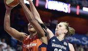 Connecticut Sun's Alyssa Thomas (25) is fouled by Washington Mystics' Emma Meeseman (33) in the second half of a WNBA basketball game Saturday, July 8, 2017, in Uncasville, Conn. (Sean D. Elliot/The Day via AP) **FILE**