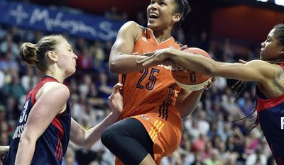 Connecticut Sun's Alyssa Thomas (25) is fouled by Washington Mystics' Tierra Ruffin-Pratt, right, on a drive as Mystics' Emma Meeseman, left, defends in the second half of a WNBA basketball game Saturday, July 8, 2017, in Uncasville, Conn. (Sean D. Elliot/The Day via AP)