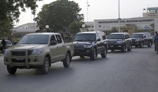 Pakistan army escort vehicles carrying Ronaldinho, Ryan Giggs and other soccer stars upon their arrival for an exhibition soccer match in Karachi, Pakistan, Saturday, July 8, 2017. Ronaldinho and Ryan Giggs were among soccer stars to arrive in Pakistan on Saturday to play exhibition matches which organizers hope will boost the sport in the country. (AP Photo/Shakil Adil)
