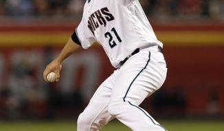 Arizona Diamondbacks starting pitcher Zack Greinke throws in the first inning during a baseball game against the Cincinnati Reds, Friday, July 7, 2017, in Phoenix. (AP Photo/Rick Scuteri)
