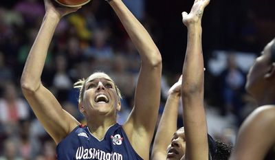 Washington Mystics' Elena Delle Donne shoots over Connecticut Sun's Alyssa Thomas in the first half of a WNBA basketball game Saturday, July 8, 2017, in Uncasville, Conn. (Sean D. Elliot/The Day via AP) **FILE**