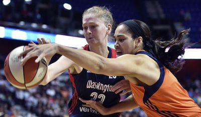 Connecticut Sun's Brionna Jones, right, battles Washington Mystics' Emma Meesseman (33) for a rebound in the first half of a WNBA basketball game Saturday, July 8, 2017, in Uncasville, Conn. (Sean D. Elliot/The Day via AP) **FILE**