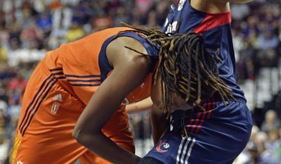 Connecticut Sun's Jonquel Jones, left, is fouled by Washington Mystics' Krystal Thomas in the first half of a WNBA basketball game Saturday, July 8, 2017, in Uncasville, Conn. (Sean D. Elliot/The Day via AP)
