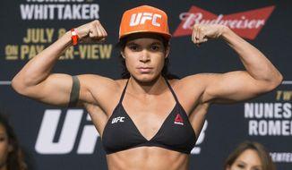 Amanda Nunes poses during the UFC 213 ceremonial weigh-ins, Friday, July 7, 2017, in Las Vegas. (Erik Verduzco/Las Vegas Review-Journal via AP)