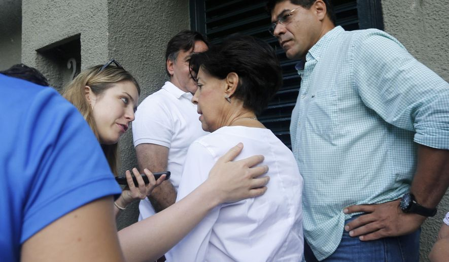"Antonieta Mendoza, center, the mother of opposition leader Leopoldo Lopez speaks with media members upon her arrival to the home of her son in Caracas, Venezuela, Saturday, July 8, 2017.  Lopez has been transferred to house arrest.The court says in a statement early Saturday that Lopez was granted the ""humanitarian measure"" for health reasons. The 46-year-old Lopez has been behind bars at a military prison for more than three years. (AP Photo/Ariana Cubillos)"