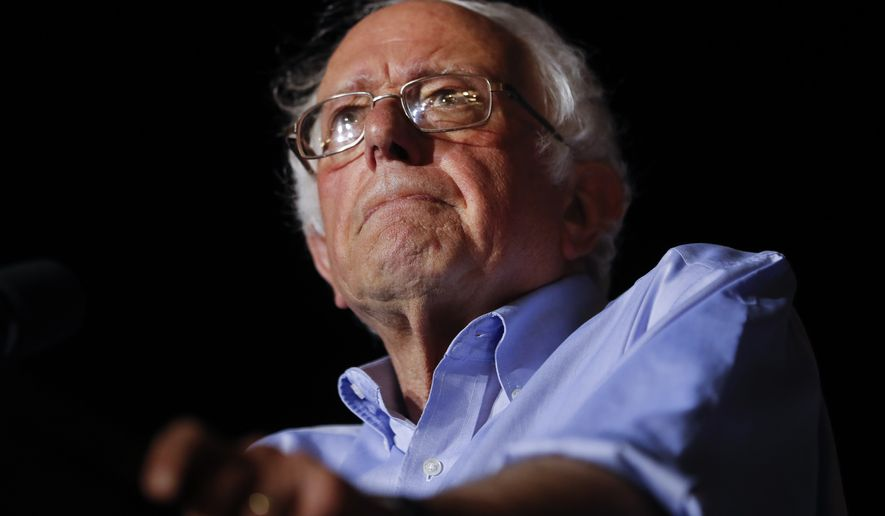"Sen. Bernie Sanders, I-Vt., pauses as he speaks during a ""Care Not Cuts"" rally in support of the Affordable Care Act, Sunday, July 9, 2017, in Covington, Ky. (AP Photo/John Minchillo)"