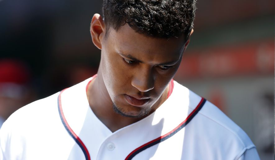 Washington Nationals starting pitcher Joe Ross (41) walks in the dugout before a baseball game against the Atlanta Braves at Nationals Park, Sunday, July 9, 2017, in Washington. (AP Photo/Alex Brandon)