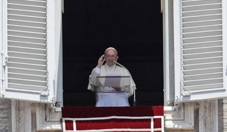 Pope Francis waves to the crowd as he prepares to recite the Angelus noon prayer from the window of his studio overlooking St.Peter's Square, at the Vatican, Sunday, July 9 , 2017. (AP Photo/Alessandra Tarantino)