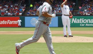 Los Angeles Angels' Albert Pujols approaches home after hitting a solo home run off Texas Rangers starting pitcher Yu Darvish in the first inning of a baseball game in Arlington, Texas, Sunday, July 9, 2017. (AP Photo/ Richard W. Rodriguez)