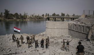 Iraqi Special Forces soldiers celebrate after reaching the bank of the Tigris river as their fight against Islamic State militants continues in parts of the Old City of Mosul, Iraq, Sunday, July 9, 2017. (AP Photo/Felipe Dana)