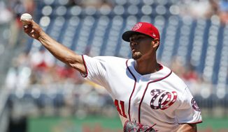 Washington Nationals starting pitcher Joe Ross throws during the first inning of a baseball game against the Atlanta Braves at Nationals Park, Sunday, July 9, 2017, in Washington. (AP Photo/Alex Brandon)