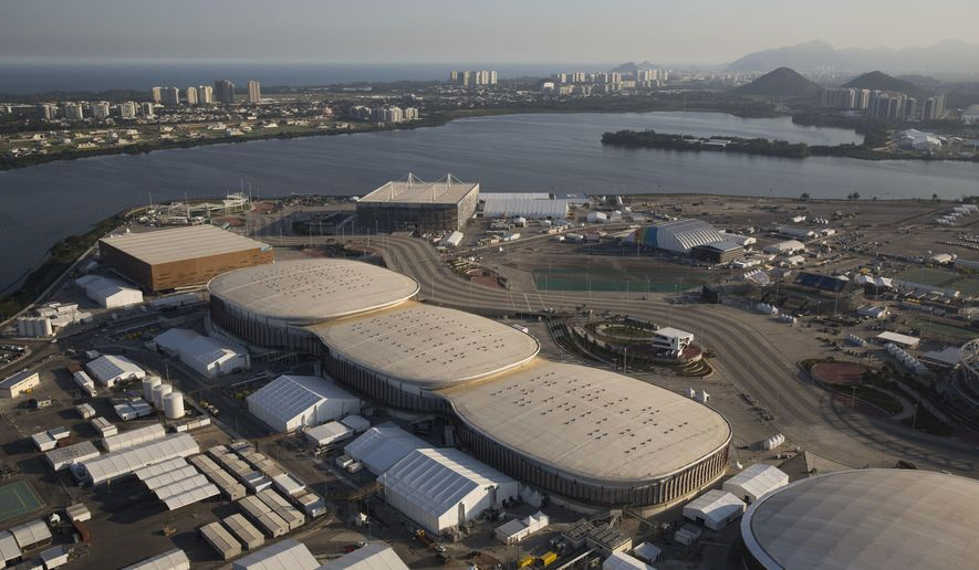File - In this July 4, 2016 file photo, the Olympic Park of the 2016 Olympics is seen from the air, in Rio de Janeiro, Brazil. The International Olympic Committee said on Sunday, July 9 2017, that it has declined to step in and help Rio Olympic organizers with a debt estimated at between $35-40 million.(AP Photo/Felipe Dana, File)