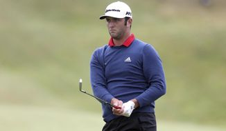 Spain's Jon Rahm during day four of the Irish Open golf tournament at Portstewart Golf Club, Northern Ireland, Sunday July 9, 2017.  Rahm, one of the hottest young players in world golf, holed out from 150 yards for eagle on No. 4 and strung together four straight birdies from No. 7 to turn what was promising to be a tight final day into a procession to win the tournament Sunday.  (Niall Carson(/PA via AP)