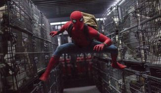 "This image released by Columbia Pictures shows Tom Holland in a scene from ""Spider-Man: Homecoming."" (Chuck Zlotnick/Columbia Pictures-Sony via AP)"