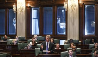 FOR USE MONDAY JULY 10, 2017 AND THEREAFTER - FILE - In this July 6, 2017 file  photo, Illinois Speaker of the House Michael Madigan, D-Chicago, gives a speech following the Illinois House voting to override Gov. Rauner's veto and pass a budget for the first time in two years at the Illinois State Capitol, in Springfield, Ill. Democratic Comptroller Susana Mendoza's staff estimates she will be able to cover expenses in August. The law allows for borrowing or taking $1.5 billion from other state funds in the interim. (Justin L. Fowler/The State Journal-Register via AP)