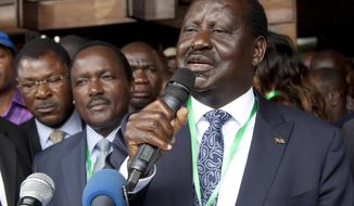 FILE - In this file photo dated Sunday, May 28 2017, National Super Alliance (NASA) Presidential candidate Raila Odinga, addresses supporters after he presented his presidential papers in Nairobi, Kenya, Sunday, May 28 2017.  Odinga has been taken to the hospital with suspected food poisoning, according to a spokesman Sunday July 9, 2017. (AP Photo/Sayyid Abdul Azim, FILE)