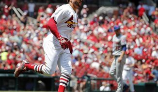 St. Louis Cardinals' Tommy Pham, left, rounds the bases after hitting a two-run home run off New York Mets starting pitcher Steven Matz during the third inning of a baseball game Sunday, July 9, 2017, in St. Louis. (AP Photo/Jeff Roberson)