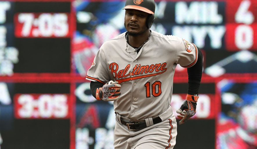 Baltimore Orioles' Adam Jones rounds second base with a three-run home run off Minnesota Twins pitcher Kyle Gibson in the first inning of a baseball game Sunday, July 9, 2017, in Minneapolis. (AP Photo/Tom Olmscheid)
