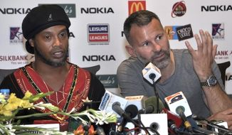 Manchester United legend Ryan Giggs, right, speaks next to Brazilian soccer star Ronaldinho, during a press conference in Lahore, Pakistan, Sunday, July 9, 2017. Ronaldinho and Giggs were among the soccer stars that arrived in Pakistan to play exhibition matches which organizers hope will boost the sport in the country. (AP Photo/K.M. Chaudary)